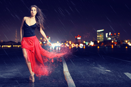 Dancing woman on a rainy street