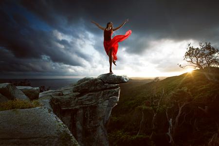 Woman dances on a rock