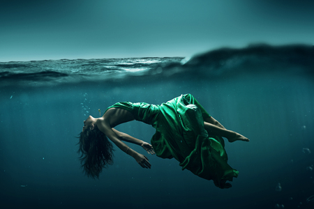 Floating woman under the water