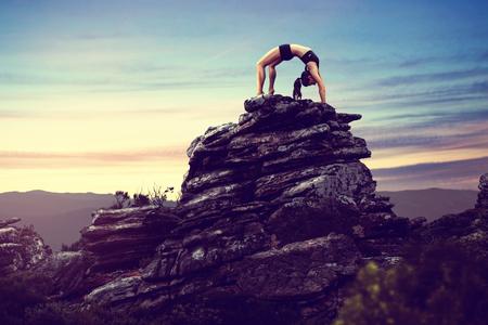 soulfulness: Woman does gymnastics on a rock