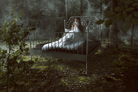 Woman wakes up in the forest