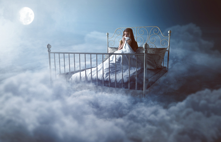 Woman wakes up in the clouds