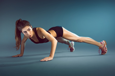 pushup: Woman performs a pushup