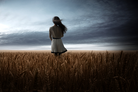 Girl in Wheat Field Stock Photo