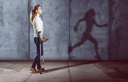 Handicapped woman with a running shadow