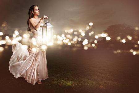 Woman with a lantern Stock Photo