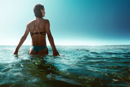 Woman walks through shallow water