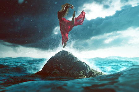 soulfulness: Woman dances on a rock in the sea