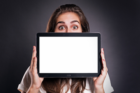 uphold: Woman holding a Tablet PC
