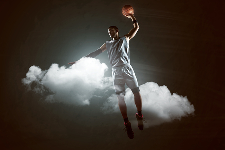 Basketballer between the clouds Stok Fotoğraf