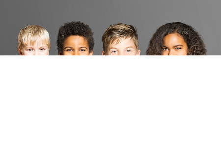 differed: Childs behind white poster Stock Photo