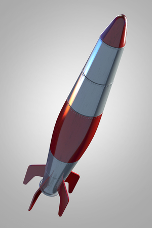 Rocket in front of grey background 写真素材