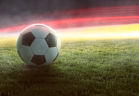 Soccerball in front of german colored light effects  (3D Rendering) 스톡 콘텐츠