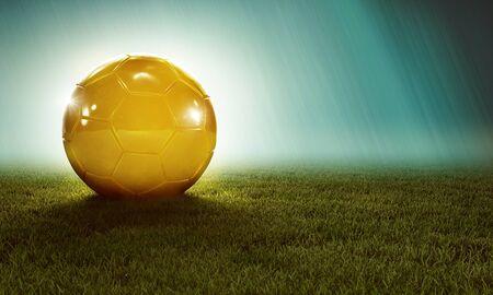 Golden ball on grass