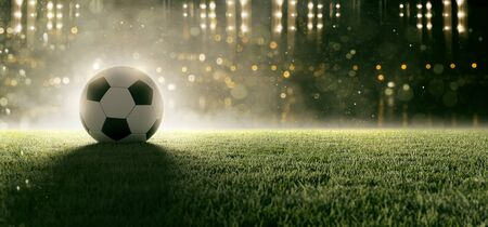 Soccer ball in stadium Stock fotó