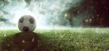 Soccer ball lays in smoke