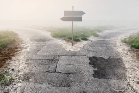 Signpost at fork in the fog