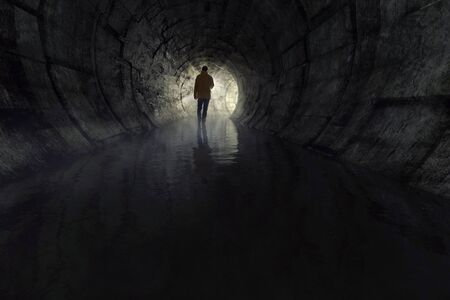 Man with a torch in a sewer