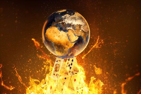 La Terre repose sur un château de cartes en feu (rendu 3D)