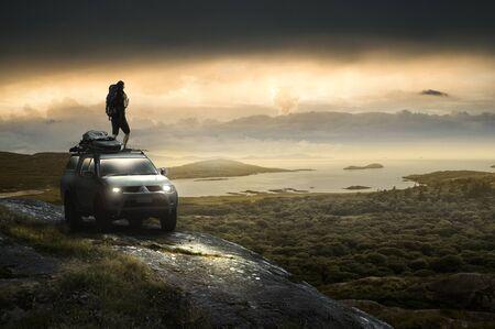 Man stands on all-terrain vehice on the coast