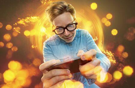 Nerd on his smartphone 写真素材