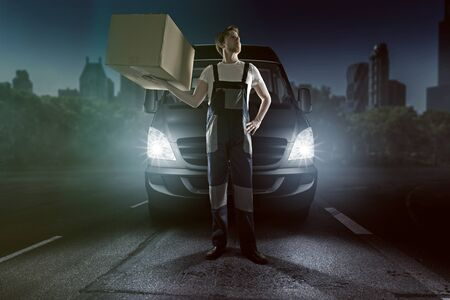 Delivery boy in front of his car