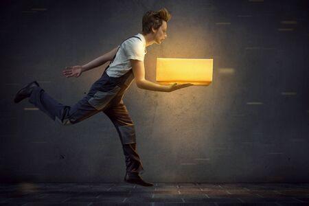 Parcel man brings luminous package 스톡 콘텐츠