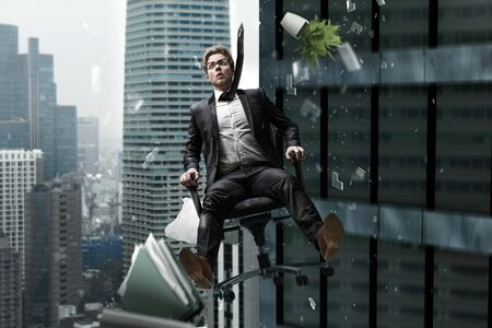 Mann falling from skyscraper in his chair