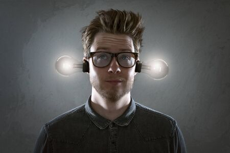 Man with lightbulbs in his ears