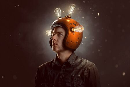 Young man with light bulb helmet