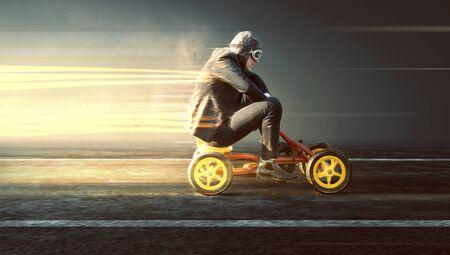 Businessman on a speeding pedal car 스톡 콘텐츠