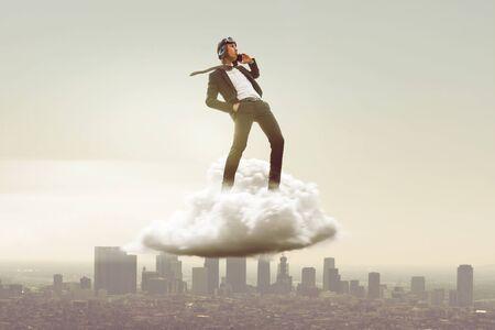 Businessman on a cloud