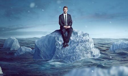 Businessman sitting on an Iceberg