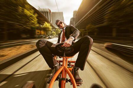 Businessman on pedal car