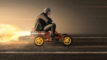Man on a rocket pedal car