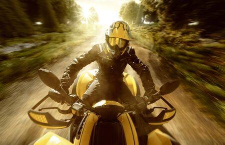 Quad biker on a forest path Stok Fotoğraf