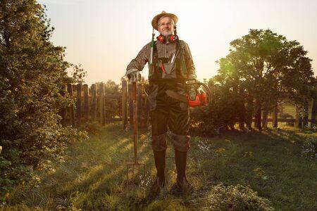 Gardener stands in his unkempt garden