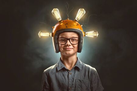 Clever kid with light bulb helmet