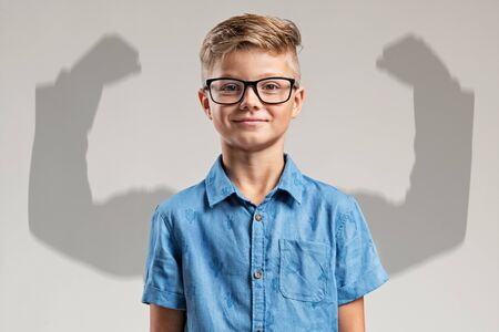 Child in front of big arms shadow
