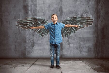 Child spreads its wings 스톡 콘텐츠