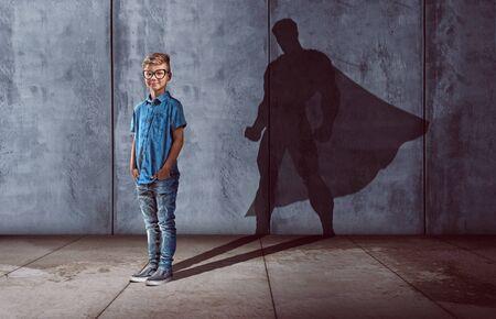Child with superhero shadow