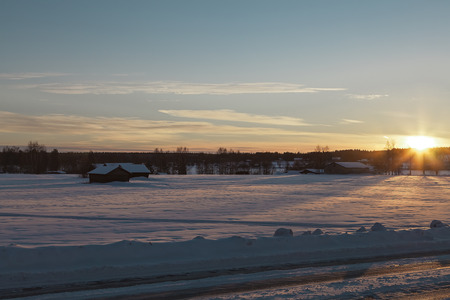 barns winter: In chase of the sun in a winter field
