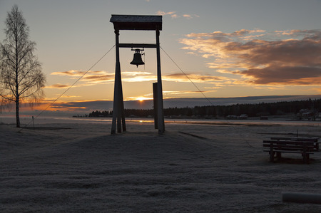frosty morning: A bell tower in the sunrise on a frosty morning