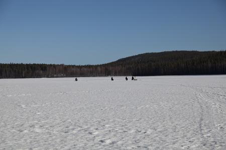 frozen lake: Winter fishing on a frozen lake