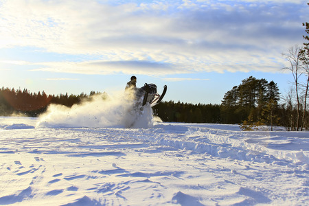 deep powder snow: Flying high with a snowmobile Stock Photo