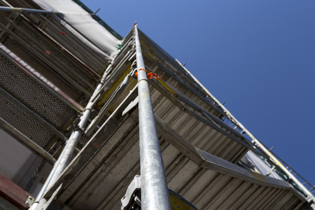 upward climb: A scaffolding for reaching the top and work safely Stock Photo