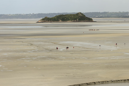 st  michel: A group of tourists walking to Mont St Michel Normandy France Stock Photo