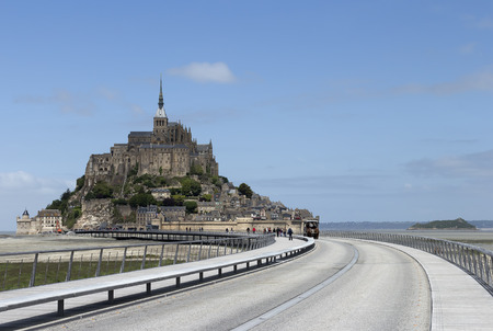 st michel: A long road for transport to Mont St Michel Normandy France Stock Photo