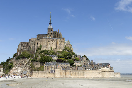 michel: A distance photo on Mont St Michel in Normandy France with a blue sky and some clouds