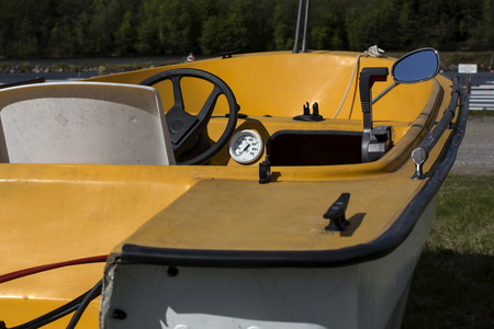 throttle: A boat on a trailer wating to get in the water some details visible